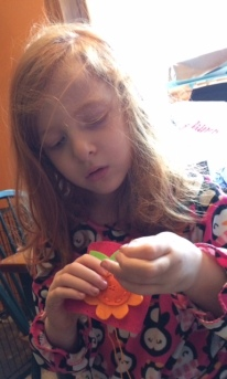 Sewing her change purse!